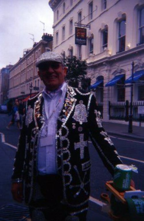 a man in a suit and tie standing on a street corner. london, film, 35mm, holga, lomo, lomography, slide, coventgarden, expired, k202. buy photo