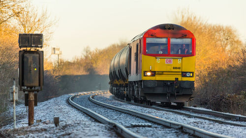 A lovely crisp December morning sees DB Class 60 no 60040 approaching the Diamond Crossing at Newark on 06-12-2014 with a Lindsey to Kingsbury loaded oil train. uk, greatbritain, autumn, england, sun, cold, color, colour, colors, sunshine, contrast, train, canon, flickr, december, colours, dof, unitedkingdom, sunny, trains, frosty, db, 5d, tug, newark, frontpage, britishrail, nottinghamshire, charter, sunnyday, steamtrain, 2014, canon100400l, networkrail, newarkcastle, decembersun, class60, newarknorthgate, 60040, dbschenker, canon5dmk3, railcharter, 5dmk3, 5d3, 5diii, canoneos5dmk3, newarkdiamondcrossing, ilobsterit. buy photo