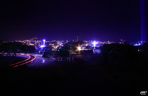 a view of a city street at night. road, city, light, lightpainting, car, night, dark, way, town, noir, ray, cross, pacific, voiture, route, warren, rayon, nouvellecalédonie, newcaledonia, nuit, ville, caledonia, chemin, croix, noumea, pacifique, calédonie, nouméa, mazoyer. buy photo