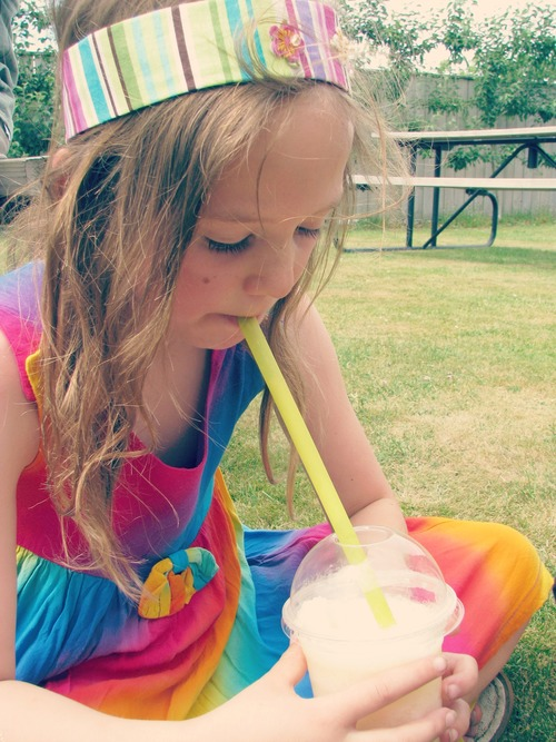 Sadie and her pure apple juice slushy. friends, summer, sadie, slushy, greytown, cuckoocafe. buy photo