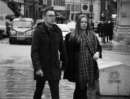 Couple walking on Great Queen Street, Covent Garden, London WC2, 14th Feb 2015. people, london, monochrome, coventgarden, westend. buy photo