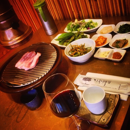 a table topped with plates and bowls of food. buy photo