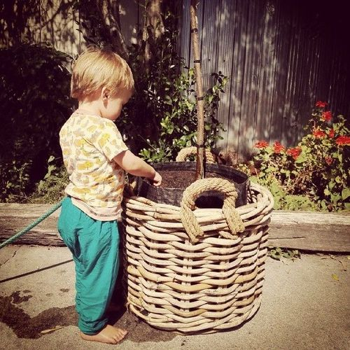 Helping mama and daddy pot up shrubs for the cafe.. square, squareformat, earlybird, iphoneography. buy photo