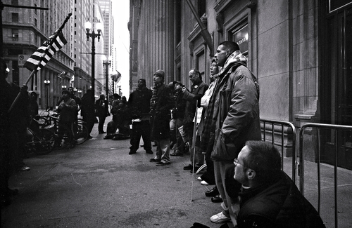 """Occupy Chicago"" - TMAX 400 - 26 Nov 2011. poverty, street, city, people, urban, blackandwhite, bw, chicago, blancoynegro, film, monochrome, mono, 1, blackwhite, movement, zwartwit, kodak, tmax, district, protest, streetphotography, bank, gritty, financialdistrict, demonstration, 99, depression, housing, wallstreet, economic, tmax400, financial, meltdown, crisis, demonstrators, chicagos, unemployment, cme, straat, 99percent, tmx, recession, chicagoist, boardoftrade, 2011, foreclosure, bailout, occupy, straatfotografie, blancetnoire, schwarzundweisse, housingcrisis, occupychicago. buy photo"