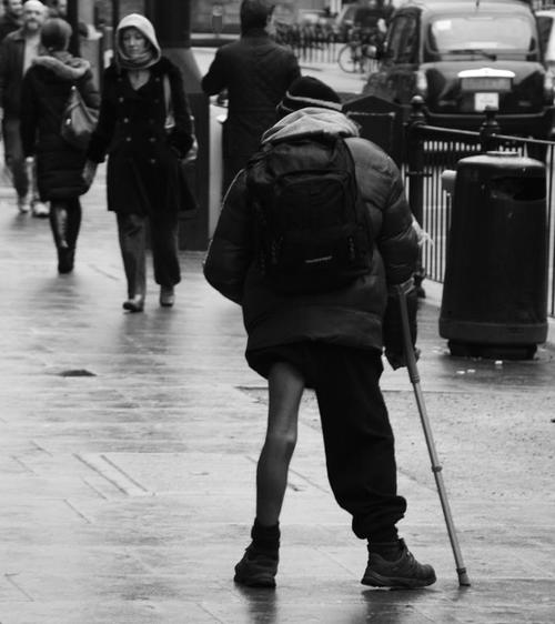 Homeless man, Kingsway, Holborn, London WC1, 14th Feb 2015. people, london, monochrome, homeless, rainy, westend. buy photo