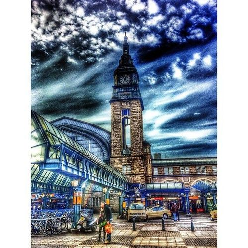 Bahnhof Hamburg, Germany  Hamburg Hauptbahnhof (abbrev. Hamburg Hbf or Hambg Hbf) is the main railway station for the German city of Hamburg and is classified by Deutsche Bahn as a category 1 station.  Photo by @Octavst © #octavst  #hdr #hdr_pho. square, squareformat, iphoneography. buy photo