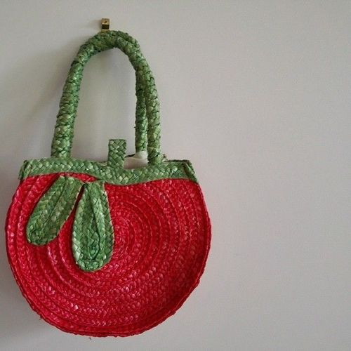 Op-shop find. Everyone needs a rafia bag shaped like an apple.. square, squareformat, iphoneography. buy photo
